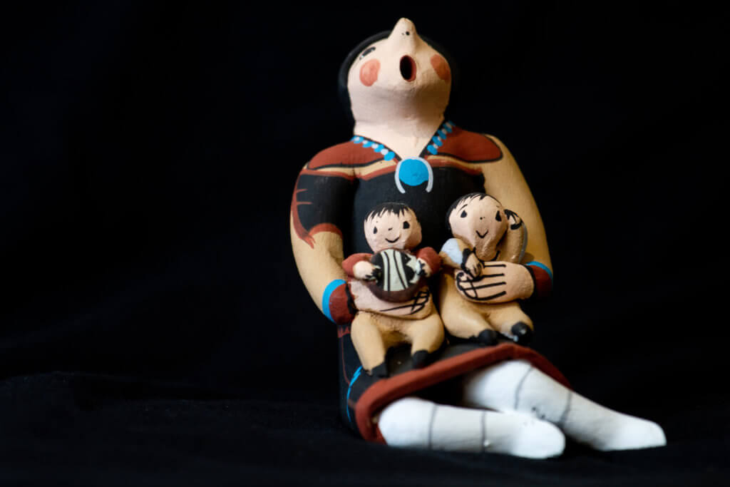 hand crafted pottery family with mother and children