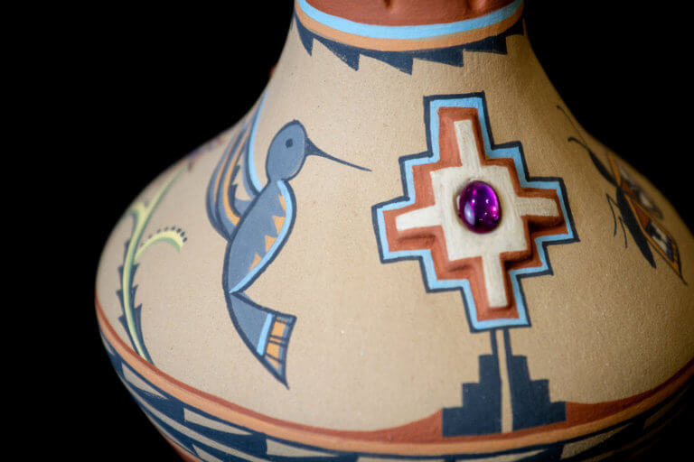native american pottery with painted humming bird
